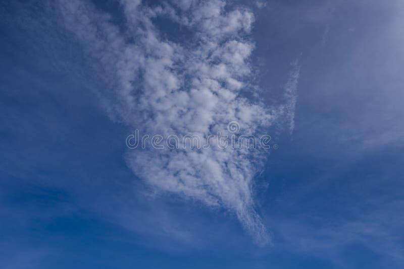Fantastic soft white clouds against blue sky stock photos