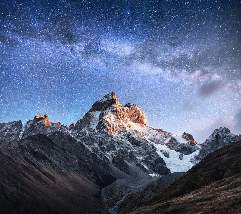 Fantastic starry sky. Autumn landscape and snow-capped peaks. Main Caucasian Ridge. Mountain View from Mount Ushba Meyer. Georgia. Europe stock image