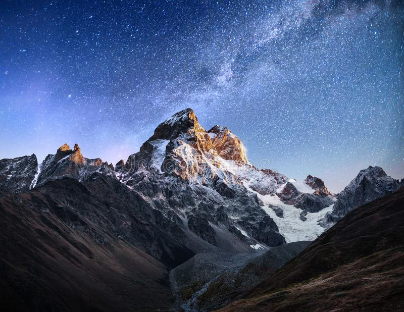 Fantastic starry sky. Autumn landscape and snow-capped peaks. Main Caucasian Ridge. Mountain View from Mount Ushba Meyer. Georgia. Europe royalty free stock photography