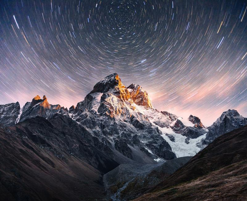 Fantastic starry sky. Snow-capped peaks. Main Caucasian Ridge. Mountain View from Mount Ushba Meyer, Georgia. Europe.  royalty free stock images