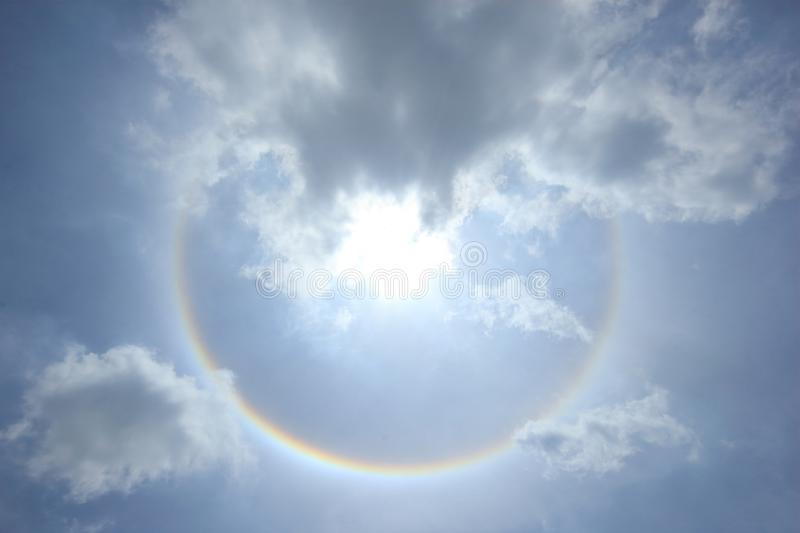 Fantastic sun halo with cloud and sky background, Phenomenon of nature. Around, atmosphere, beautiful, blue, bright, circle, circular, cirrus, cloudscape, day stock photo