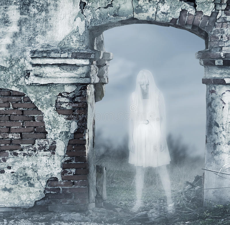 Fantastic transparent white woman ghost. With a bloody hatchet in hand stock photo