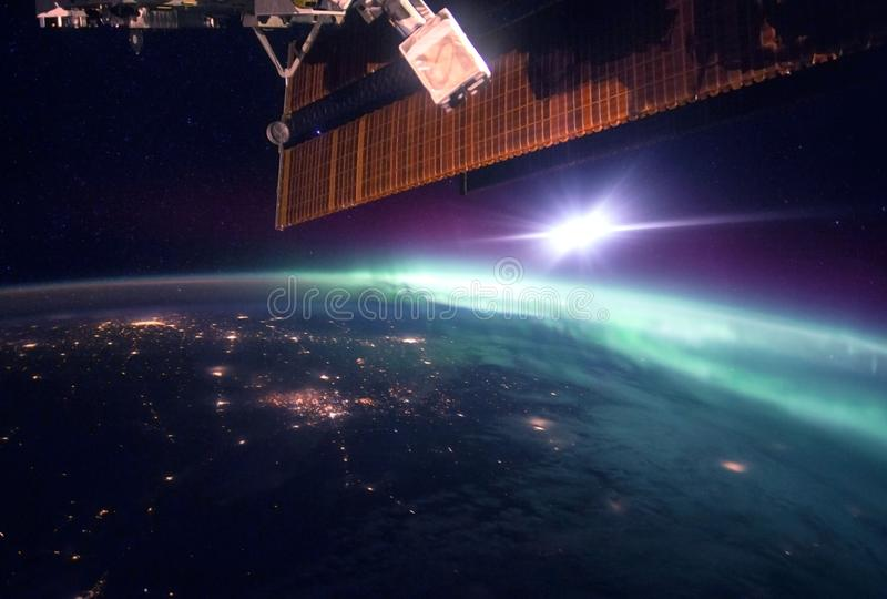 Fantastic view of the northern lights from space.  Elements of this image were furnished by NASA. Fantastic view of the northern lights from space. Elements of royalty free stock images