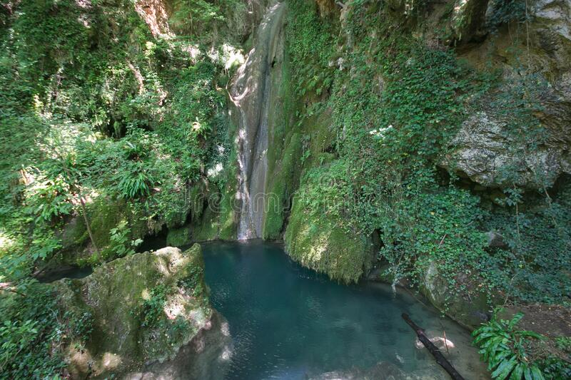 Fantastic view of wild waterfall with lake in the forest near Castel di Fiori, Terni, Umbria royalty free stock photos