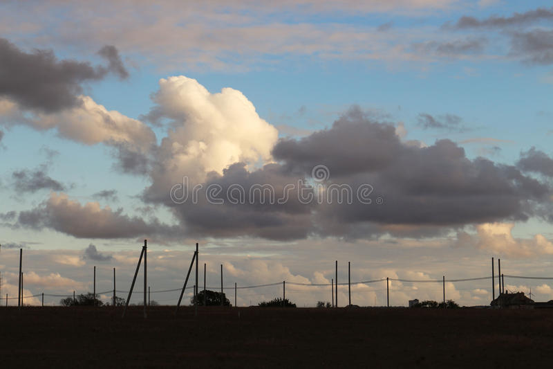 Fantastic visual forms of clouds over the settlement royalty free stock photos