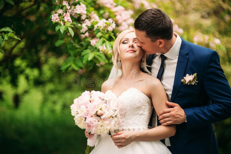 Fantastic wedding couple show their love stock photography
