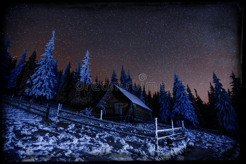 Fantastic winter meteor shower and the snow-capped mountains. Vi royalty free illustration
