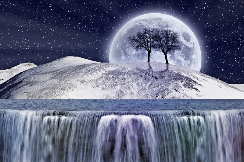 Fantastic winter moonlight. Fantasy waterfall and snowy mountain in the moonlight