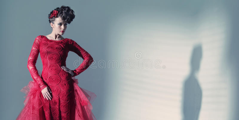 Fantastic woman wearing fashionbable red dress royalty free stock photos