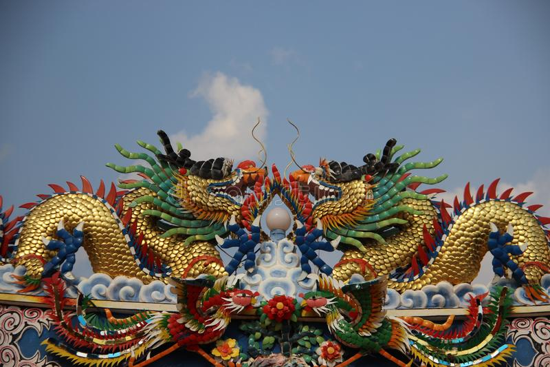 Shrine. Multicolor Ceramic Dragons And Birds With Gray Sky royalty free stock photos