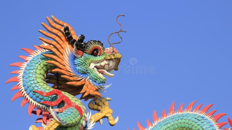 Multicolor Ceramic Dragons With Blue Sky And Sunny. Still life Moses Dragons colorful fantasy animals decoration on shrine roof summer time in Khonkaen Thailand royalty free stock image