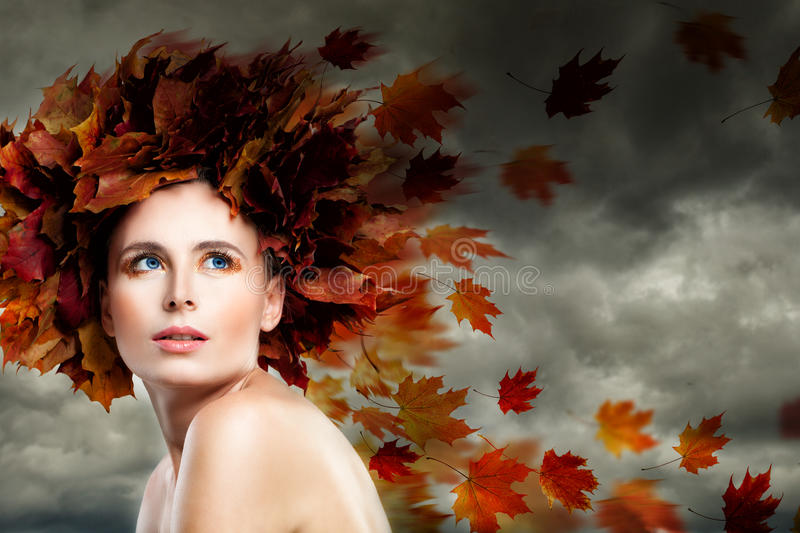 Fantasy Autumn Season Concept. Autumn Model Woman against Cloudy royalty free stock photos