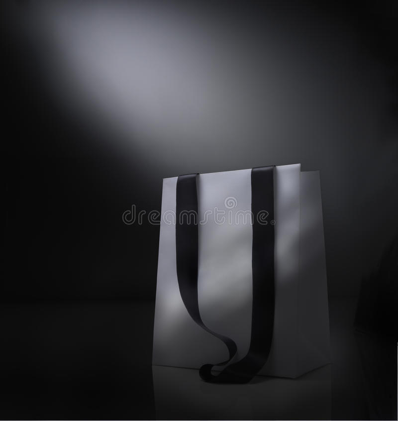 Fantasy bag. Fantasy shopping bag against black background stock photos