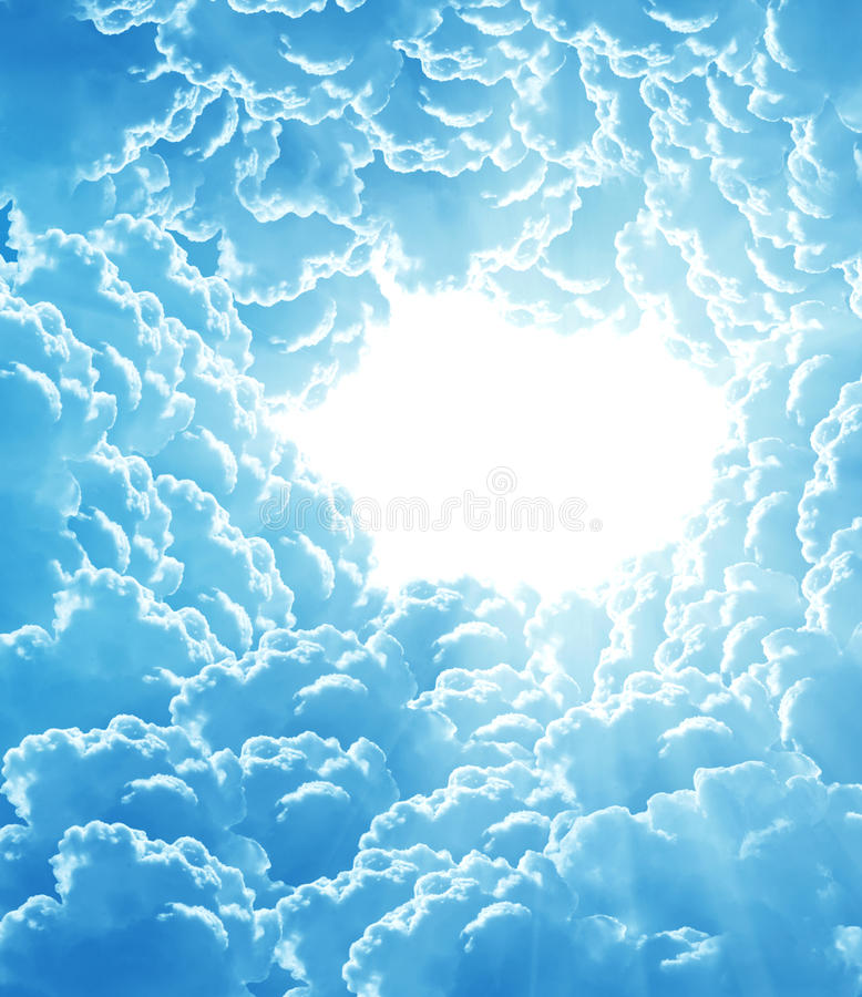Fantasy beautiful clouds. Blue sky with sun and beautiful clouds stock image