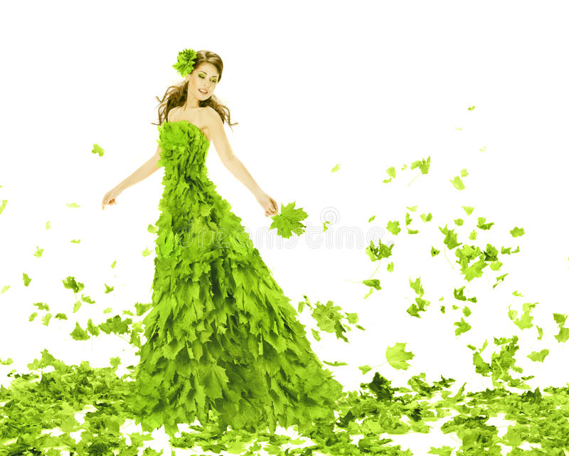 Fantasy beauty, woman in leaves dress. Fantasy beauty, fashion woman in seasons spring leaves dress. Creative beautiful girl in green summer gown, over white