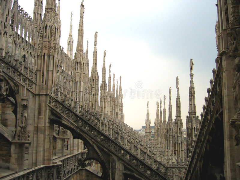 Fantasy city - Rooftops of Duomo Cathedral, Milan, Italy. The roof of the Gothic marvel of white marble (Duomo Cathedral of Milan, Italy) is like a small city of royalty free stock photo
