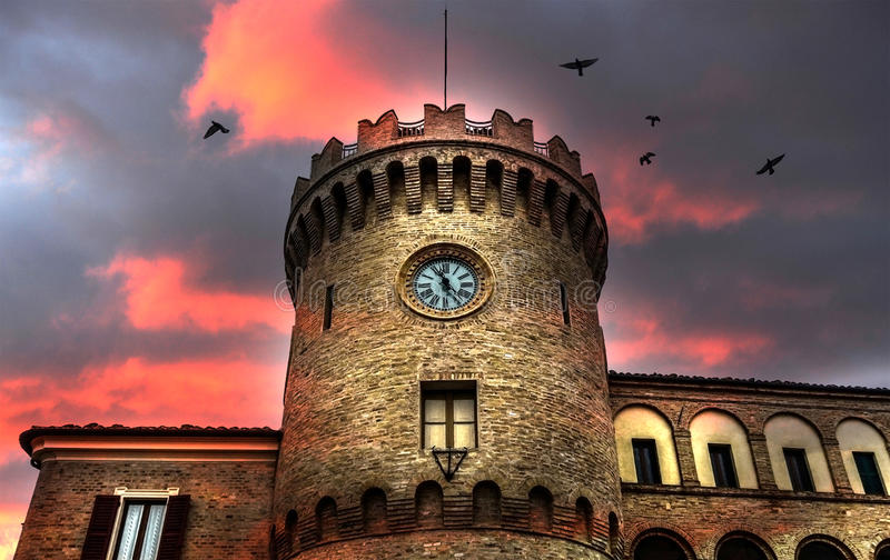 Fantasy clock tower. Antique clock tower on fantasy background royalty free stock photo