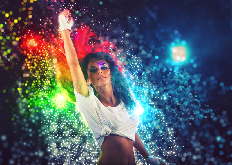 Fantasy Dance Party. Young woman performing dance at fantasy party with colorful disco lights