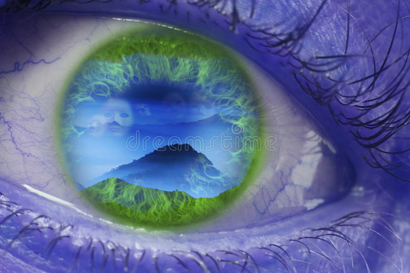Fantasy eye. With reflection of an imaginary world with faces and royalty free stock photography