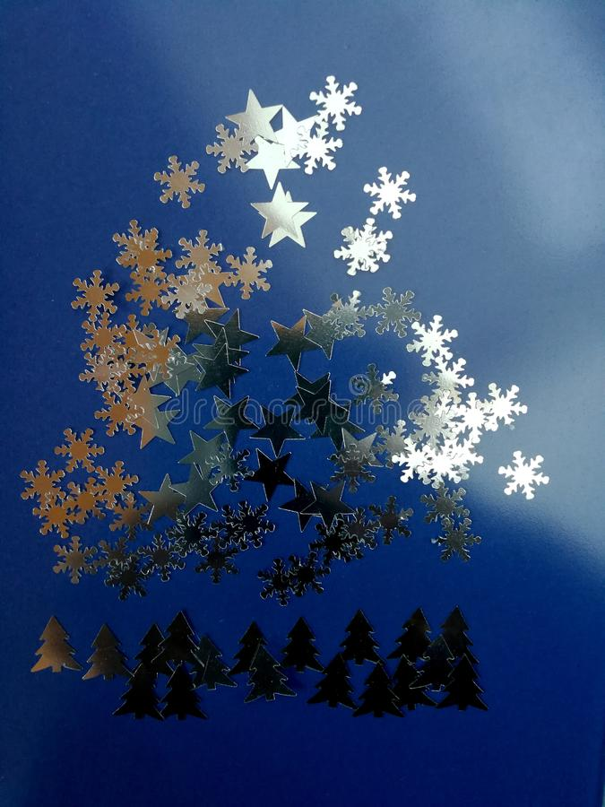 Fantasy of fir trees, stars sky and snow stock images