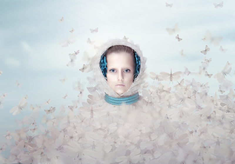 Fantasy. Futuristic Woman with Flying Butterflies royalty free stock image