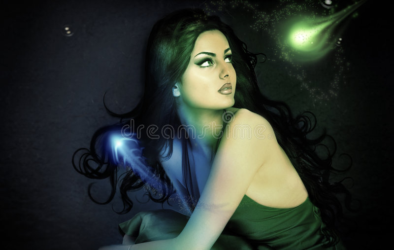 Fantasy girl. Glowing in dark with blue and green tones royalty free stock photo