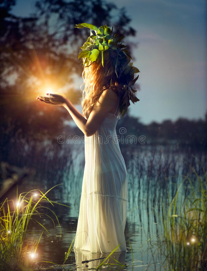Fantasy girl taking magic light stock photo