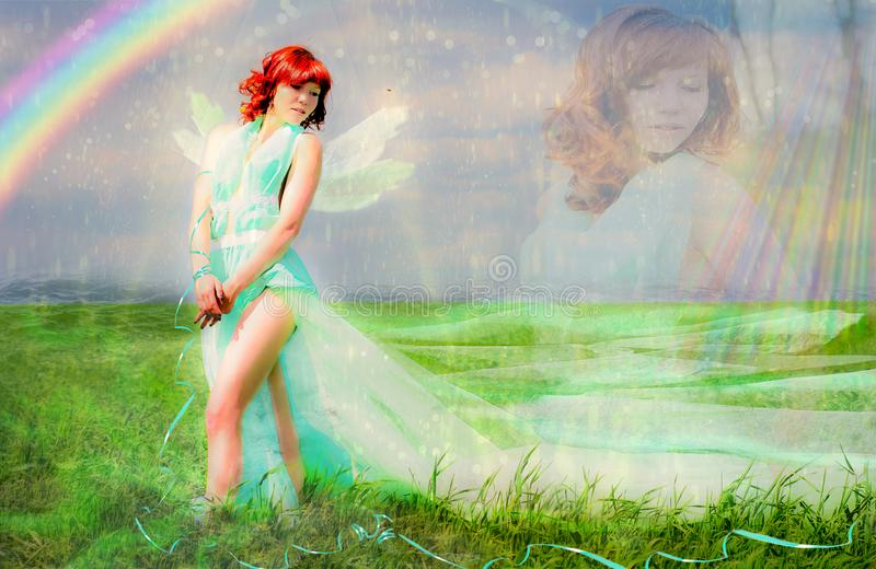 Fantasy - the goddess of spring and summer. Spring goddess of green field. A girl in a green dress with a long edge walks the green field of winter wheat, like a royalty free stock image