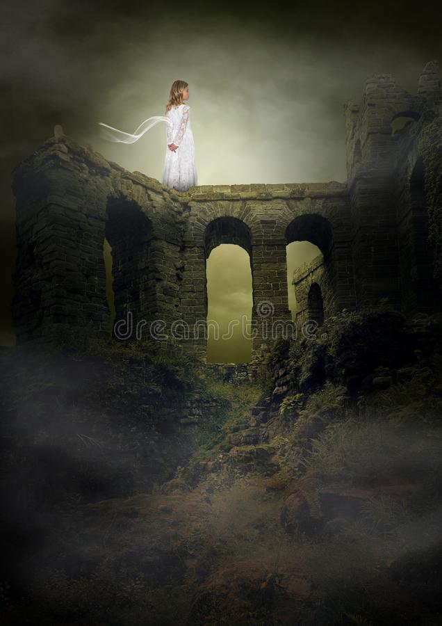 Fantasy, Imagination, Peace, Hope, Love, Spiritual. A young girl stands on ancient ruins in a surreal landscape. Abstract concept for peace, hope, love royalty free stock photos