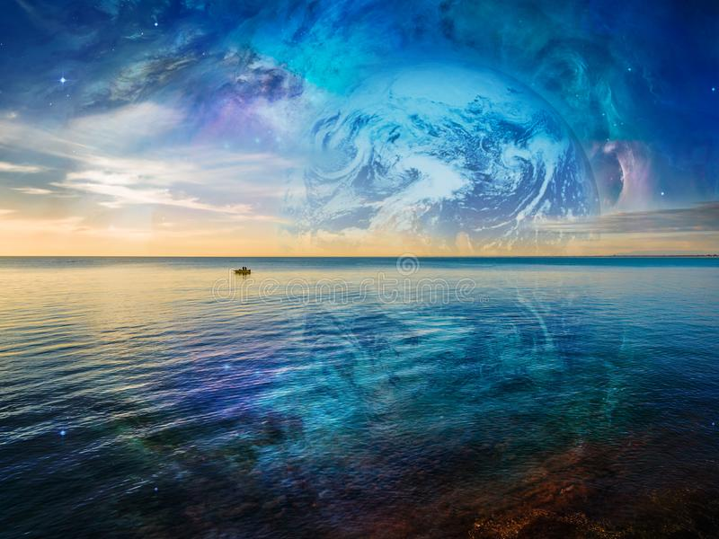 Fantasy landscape - lonely fishing boat floating on tranquil ocean water. Fantasy landscape - lonely fishing boat floating on tranquil ocean water with planet royalty free stock photo