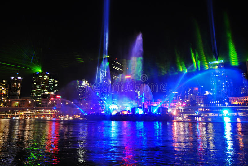 Fantasy light show in Brisbane City Australia. Fantastic light show at the Brisbane Festival on the Brisbane River with the city scyscrapers lit up behind in the royalty free stock image