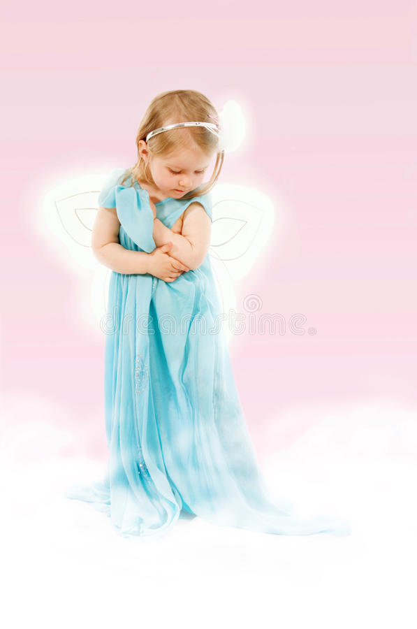 Fantasy with little girl. Of 2. 5 in a long dress on a cloud royalty free stock photos