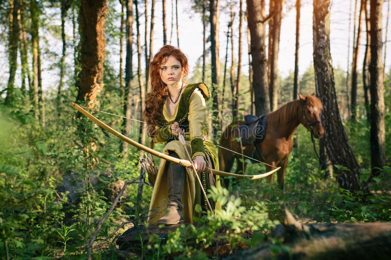 Fantasy medieval woman hunting in mystery forest royalty free stock images