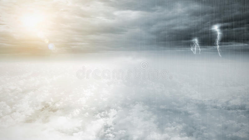 Fantasy opposite weather sky, beautiful sun and ominous stormy sky clouds, infinity conception. For composite royalty free stock photos
