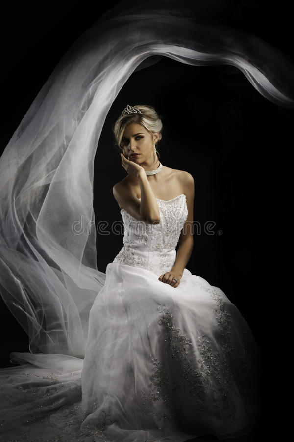 Fantasy portrait of a beautiful blonde bride royalty free stock photos