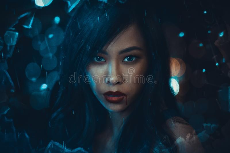 Fantasy portrait of young woman. At night rain royalty free stock image
