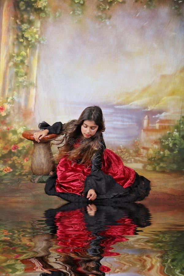Fantasy scene. Little girl dancing in a halloween costume stock photo