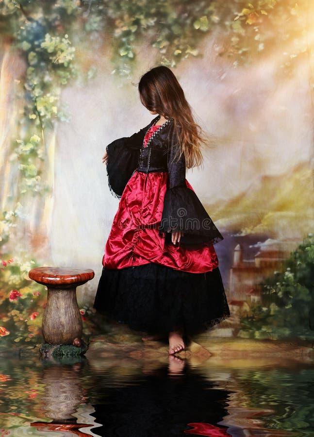 Fantasy scene. Little girl dancing in a halloween costume stock photos