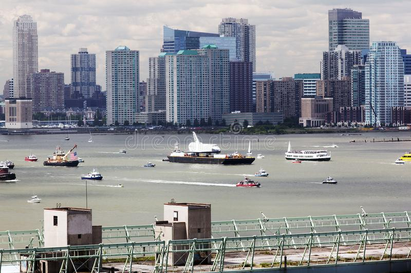 A fantasy scene, spaceship on a boat on the river next to other ships and boats in NYC.  stock photo