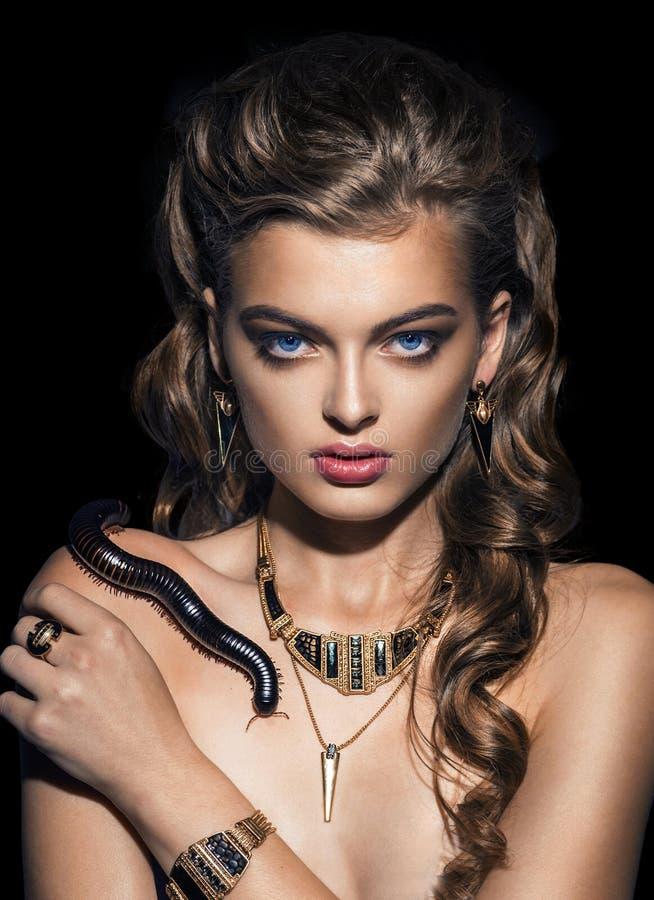 Fantasy. Snake sitting on pretty woman face. Creativity. Photo royalty free stock photos