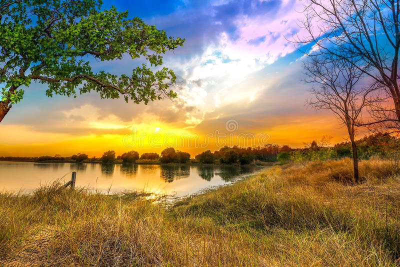 Fantasy sunset. Beautiful fantasy sunset over lake and forest scene royalty free stock photos