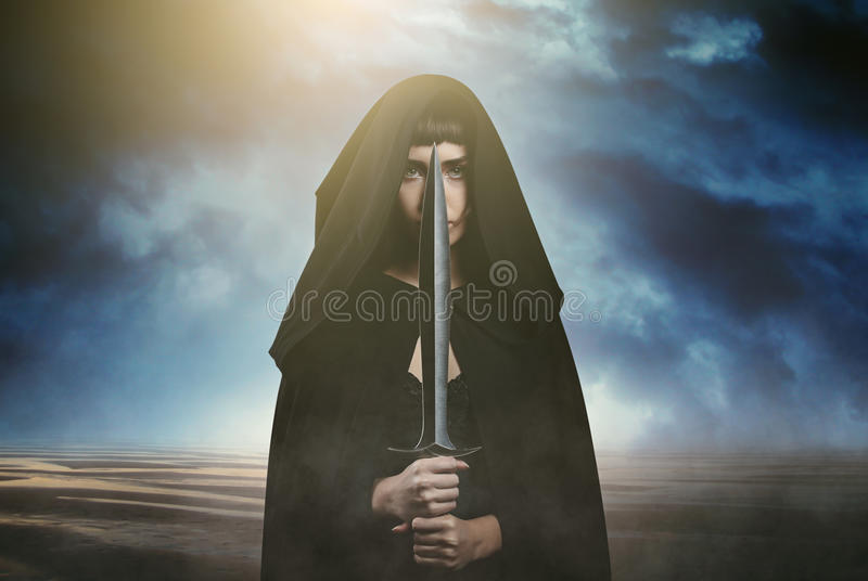 Fantasy thief and dramatic landscape. As background. Dark and surreal stock images