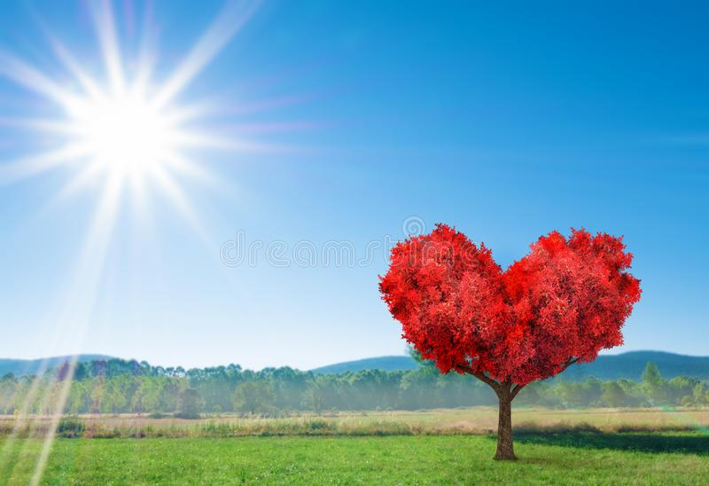Fantasy valentines landscape with red tree. In shape of heart stock photos