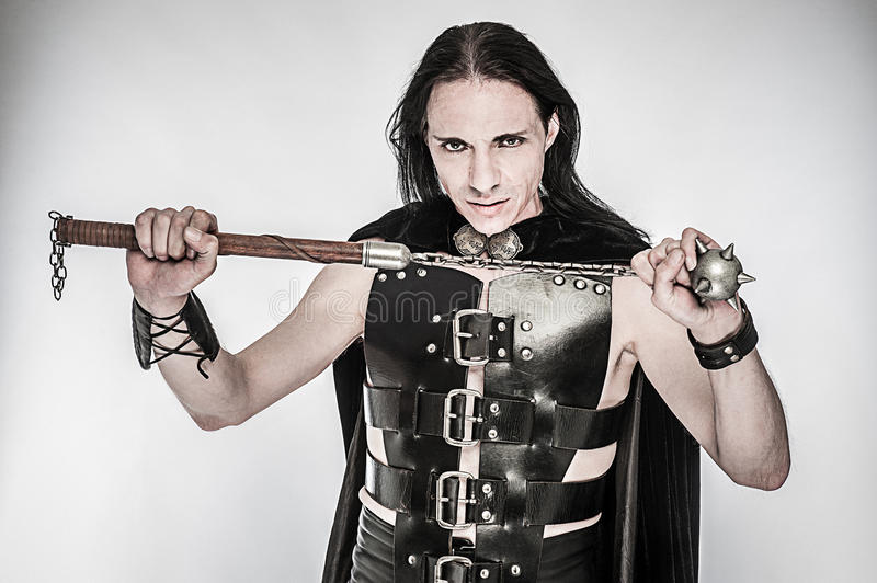 Fantasy Warrior with Spiked Club. Costume character studio shot of fantasy warrior with spiked club stock photography