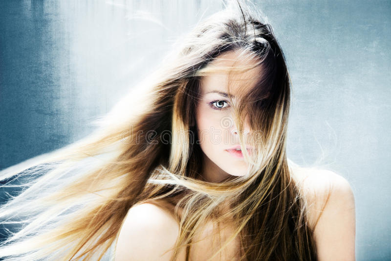 Fantasy woman. Beautiful blond hair fantasy woman portrait royalty free stock images