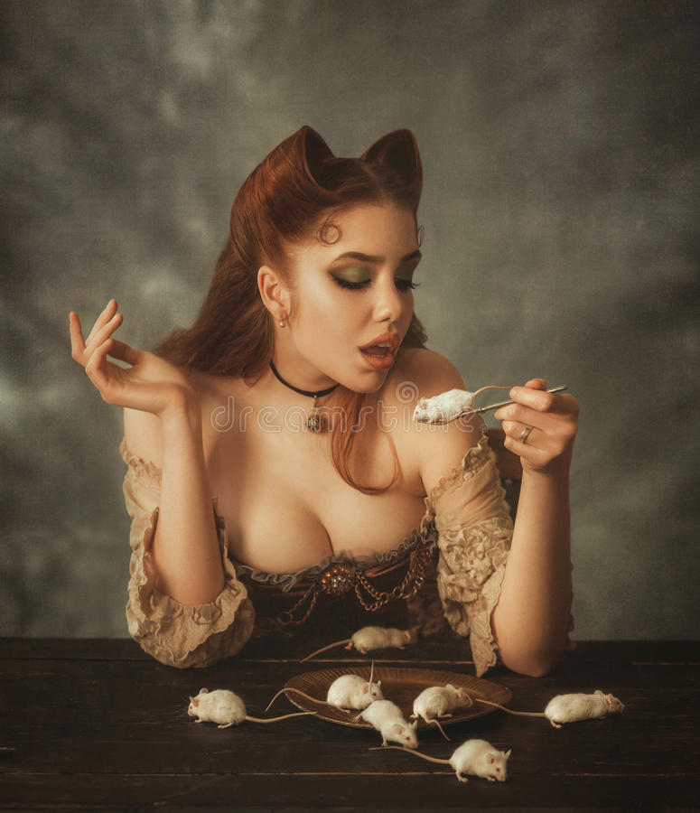 Fantasy woman cat and mouse. Artistic portrait. Fantasy woman cat and mouse. Creative colors royalty free stock photography
