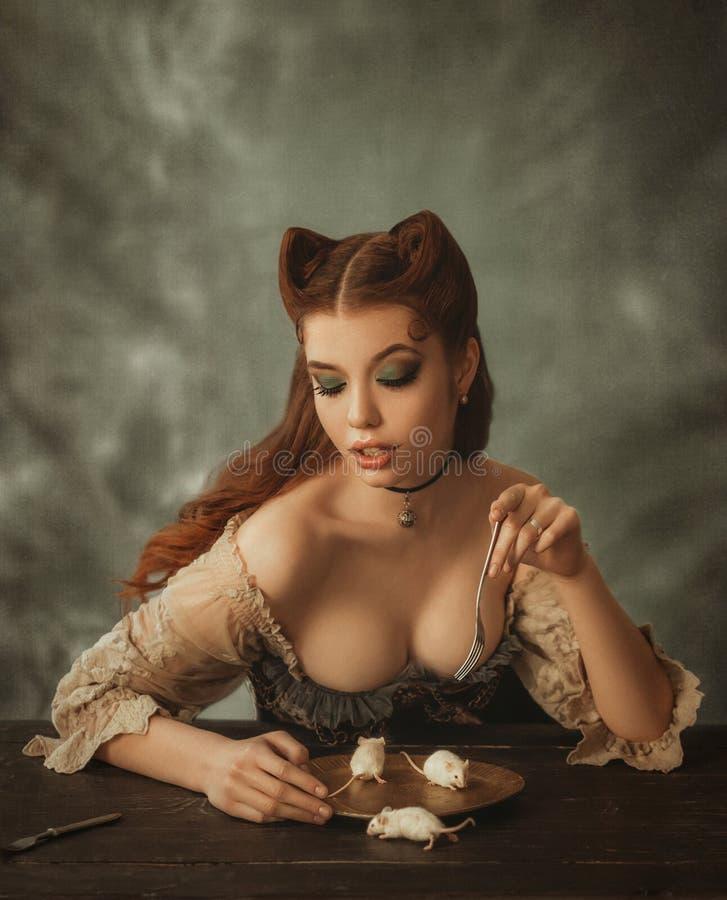 Fantasy woman cat and mouse. Artistic portrait. Fantasy woman cat and mouse. Creative colors stock photo
