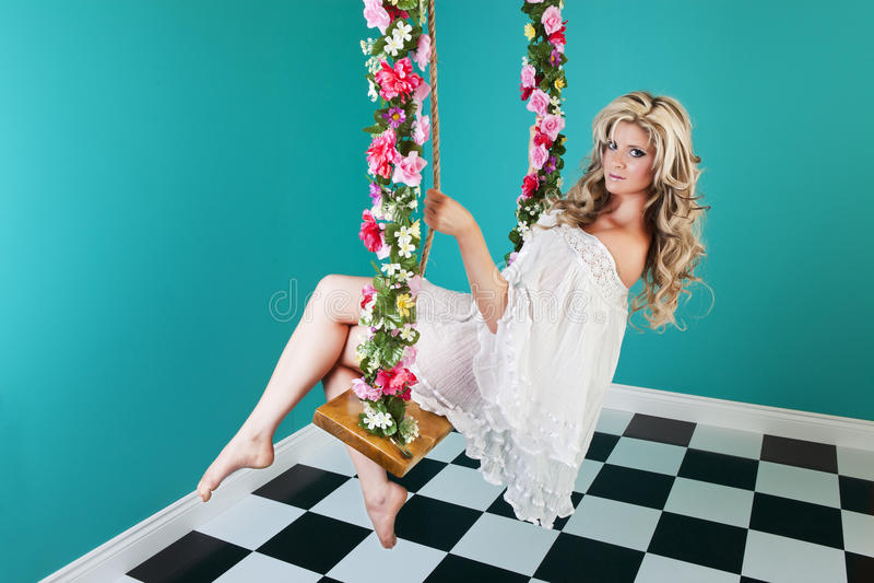 Fantasy Woman on Swing royalty free stock image