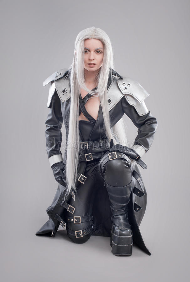 Fantasy woman warrior. Woman warrior with armor isolated on the gray background royalty free stock image