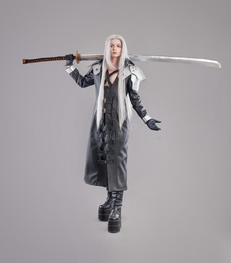 Fantasy woman warrior. Woman warrior with sword and armor on the gray background royalty free stock photos